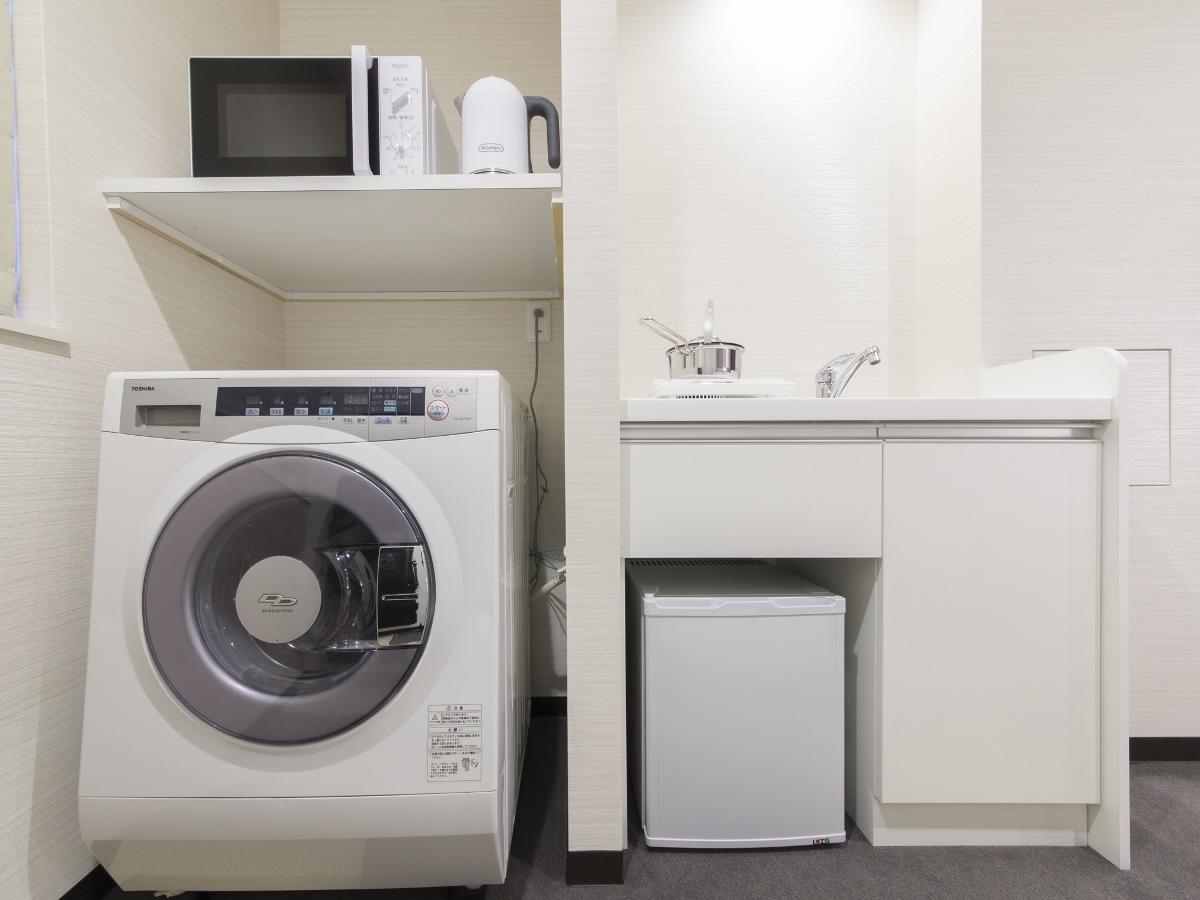 お部屋の入り口近くに、自分専用のミニキッチン、そして洗濯乾燥機まで付いているのが嬉しいです!